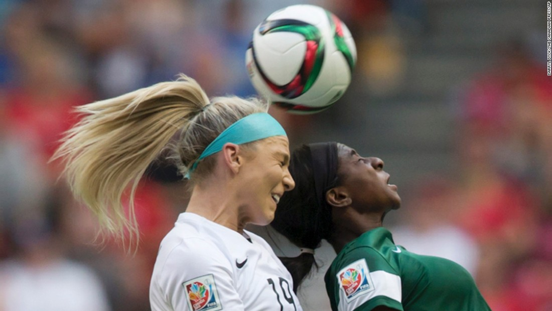 American defender Julie Johnston, left, and Nigeria's Courtney Dike compete for the ball.