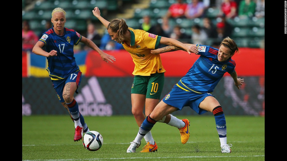 Sweden's Therese Sjogran, right, and Australia's Emily Van Egmond battle for control of the ball during a match in Edmonton on Tuesday, June 16. The match ended in a 1-1 draw.