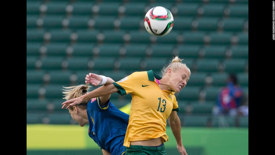 Australia's Tameka Butt, right, and Sweden's Lisa Dahlkvist compete in the second half.