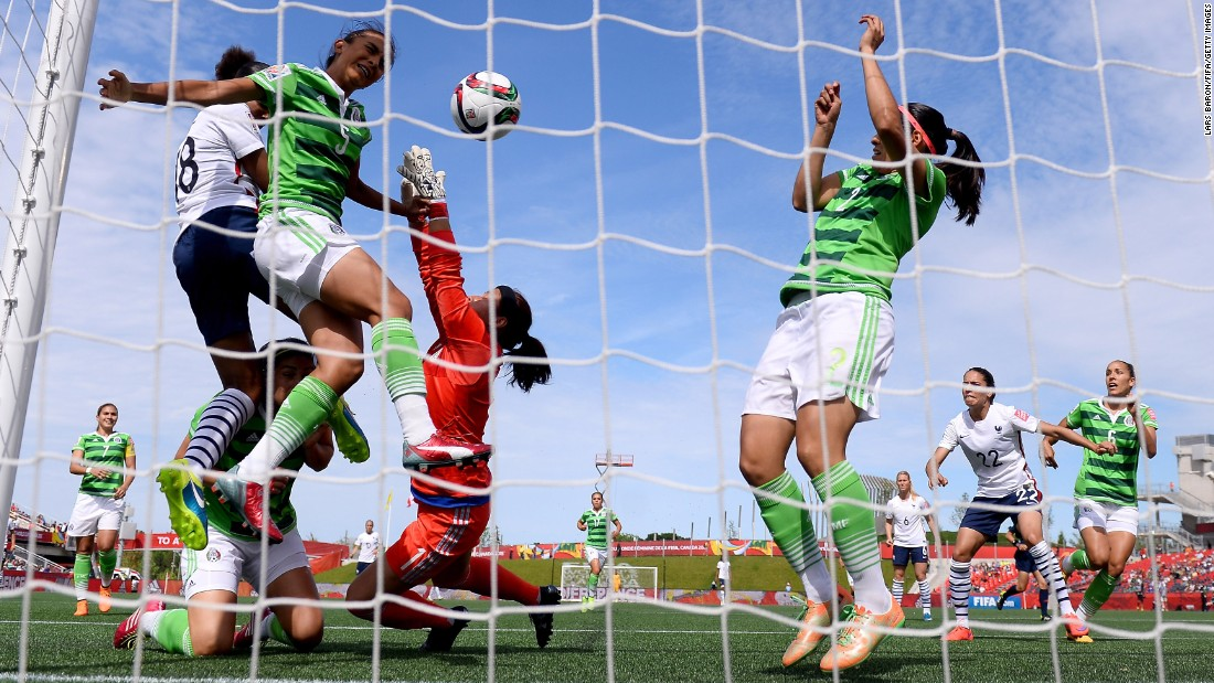 France's Marie Laure Delie, far left in white, heads her team's first goal against Mexico on June 17. France won 5-0 in Ottawa.