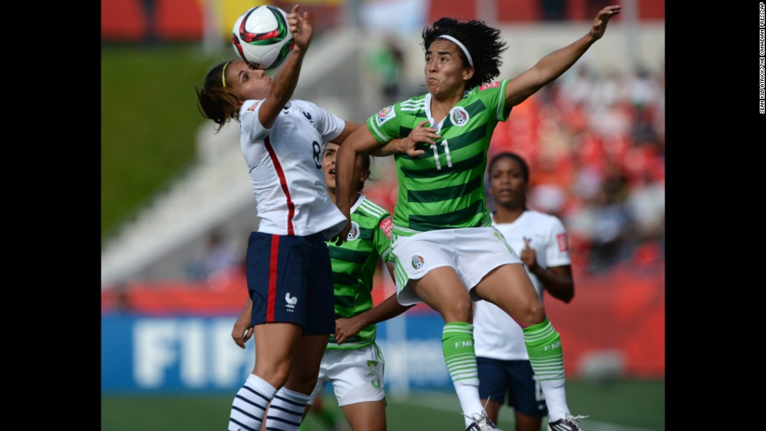 Mexico's Monica Ocampo, right, and France's Jessica Houara battle for the ball.