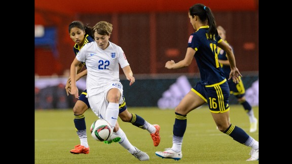 Fran Kirby of England tries to move the ball past Lady Andrade, right, of Colombia.