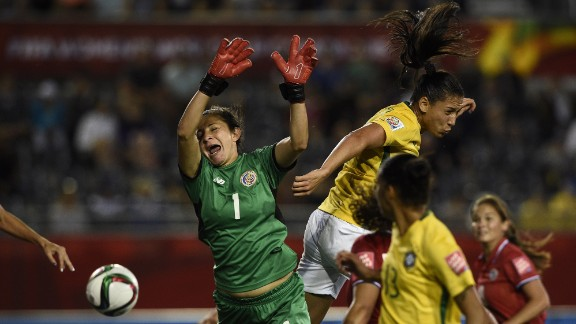 Costa Rican goalkeeper Dinnia Diaz competes for the ball.