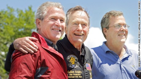A photo cutline on Page A11 Saturday should have said former President George H. W. Bush poses with his sons former President George W. Bush and Jeb Bush. It was a photographer's error. -- Gregory Rec/Staff Photographer: -- George H.W. Bush is flanked by his sons George W. Bush and (Neil Bush)* after completing a parachute jump in Kennebunkport on Friday, June 12, 2009 for his 85th birthday. -- Correct id: JEB BUSH*
