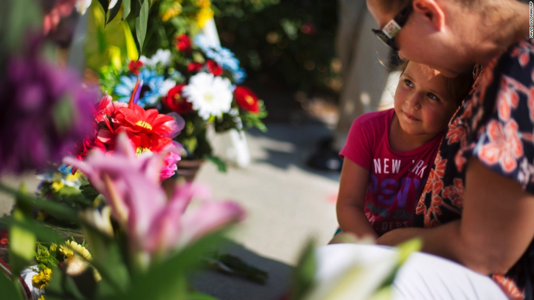 Kim Hamby prays with her daughter Kayla as they lay flowers at a makeshift memorial in Charleston on June 18.