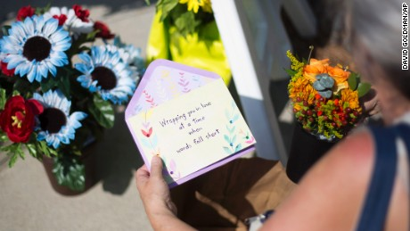 Sandra Bridges lays a card at the makeshift memorial Charleston on June 18.