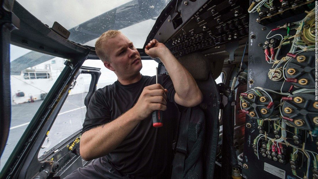 The Comfort carries engineers as well as medical staff. Pictured, an aviation electronics technician conducts maintenance inside the ship's MH-60S Sea Hawk helicopter.