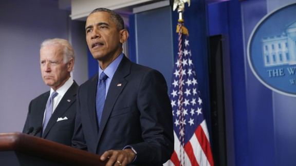 President Barack Obama, flanked by Vice President Joe Biden, makes a statement regarding the shooting in Charleston, South Carolina, June 18, 2015 at the James Brady Press Briefing Room of the White House in Washington, DC. Authorities have arrested 21-year-old Dylann Roof of Lexington County, South Carolina, as a suspect in last night
