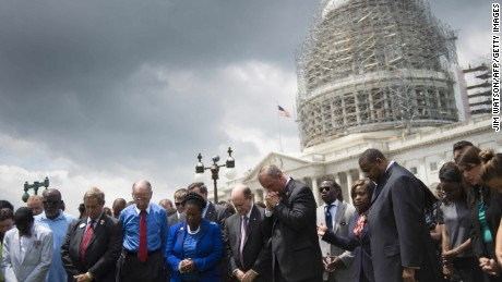 Congressmen and women gather in front of the U.S. Capitol in Washington on Thursday, June 18, during a moment of silence for the nine killed in a church shooting in Charleston, South Carolina.