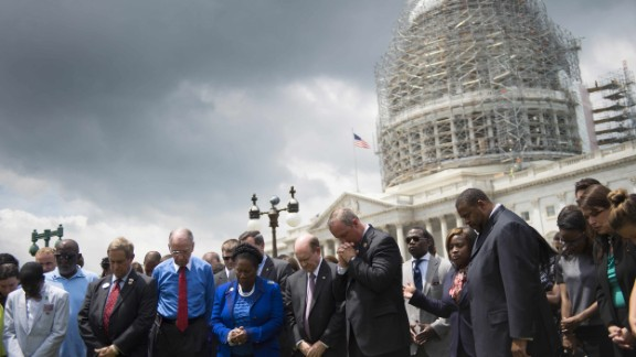 Members of the U.S. Congress gather in front of the Capitol Building in Washington on June 18, during a moment of silence for the nine killed in a church shooting in Charleston, South Carolina.