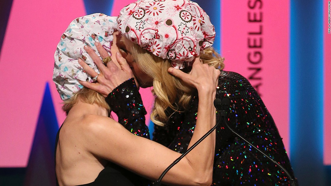 "Nicole Kidman, right, kisses fellow actress Naomi Watts while accepting an award at the Women in Film Awards on Tuesday, June 16. <a href=""http://www.eonline.com/news/667476/nicole-kidman-and-naomi-watts-lock-lips-on-stage-see-the-pics"" target=""_blank"">While talking about female empowerment,</a> Kidman described how she turned down a role when she was 14 because she had to wear a shower cap and kiss a girl. ""I was not ready to do the kind of work that threatened anybody,"" Kidman recalled, explaining the role she was offered by director Jane Campion. ""Well, today I know better and I say, 'Jane, if you're out there ... I'm ready to don this cap."" She ended her speech by saying, ""Let's stand tall and never ever apologize for it,"" and then she kissed Watts."