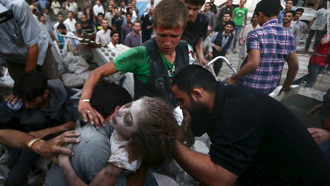 "Men hold an injured girl who was pulled from rubble in Damascus, Syria, on Tuesday, June 16. Activists said the site was heavily shelled by forces loyal to Syrian President Bashar al-Assad. <a href=""http://www.cnn.com/2015/05/22/world/gallery/syria-civil-war-pictures/index.html"" target=""_blank"">See more photos from the Syrian civil war</a>"