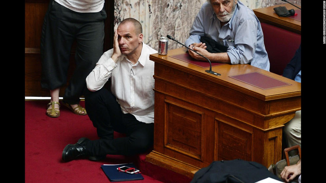 "Greek Finance Minister Yanis Varoufakis sits on the floor of Parliament as Prime Minister Alexis Tsipras speaks in Athens on Tuesday, June 16. Tsipras accused international creditors of trying to ""humiliate"" the country and called on Europe to reconsider its support of harsh reform proposals."