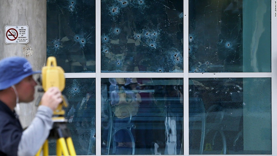 "The FBI works at the scene of a shooting Saturday, June 13, in Dallas. Earlier in the day, a man <a href=""http://www.cnn.com/2015/06/13/us/dallas-police-headquarters-shooting/index.html"" target=""_blank"">unleashed a barrage of gunfire on Dallas' police headquarters</a> and planted explosives outside the building -- narrowly failing to wound anyone. It led to a chase that ended with SWAT officers killing the man in his parked van at a restaurant parking lot."