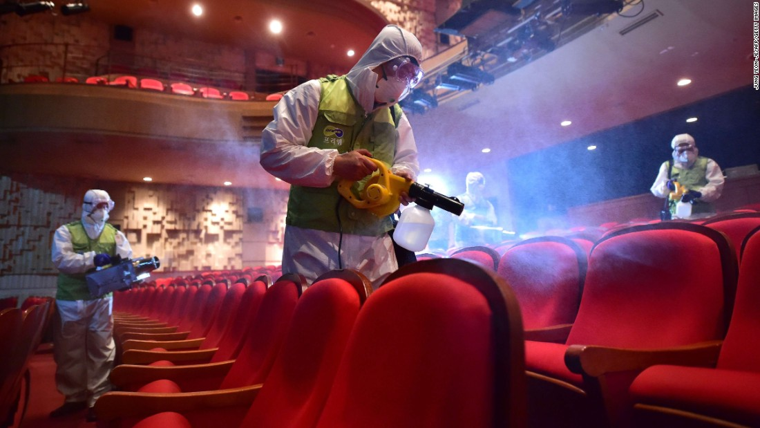 "Workers wearing protective gear fumigate a theater at the Sejong Culture Center in Seoul, South Korea, on Tuesday, June 16. The country is attempting to curb the spread of the MERS virus, <a href=""http://www.cnn.com/2015/06/15/asia/south-korea-mers-outbreak/index.html"" target=""_blank"">which has killed at least 23 people</a> there."