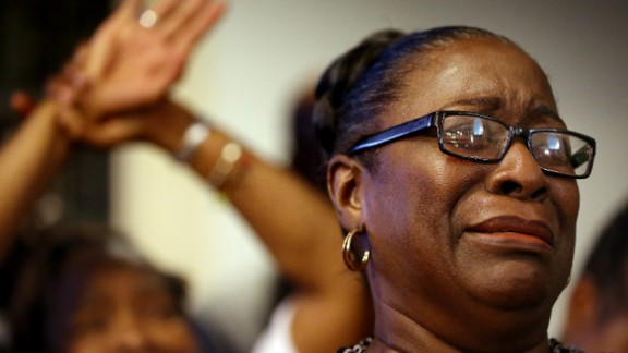 The Rev. Jeannie Smalls becomes emotional during a prayer vigil held at Morris Brown AME Church on June 18.