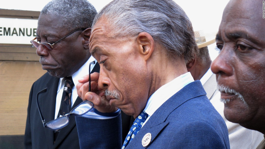 The Rev. Al Sharpton wipes away a tear after praying outside the Emanuel  AME Church in Charleston on June 18.