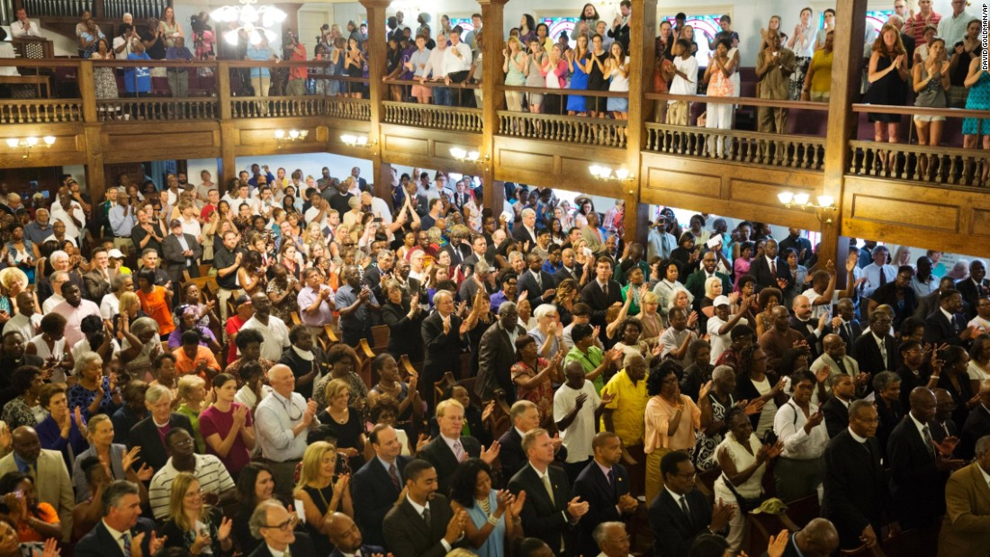 Parishioners applaud during a  memorial service on Thursday, June 18, at Morris Brown AME Church in Charleston, South Carolina.