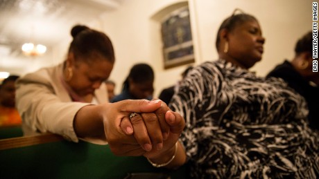 NEW YORK, NY - JUNE 18: Mourners hold a prayer vigil for the nine victims of last night's shooting at the historic Emanuel African Methodist Episcopal Church in Charleston, South Carolina June 18, 2015 at the First African Methodist Episcopal Church: Bethel in the Harlem neighborhood of New York City. Dylann Storm Roof, 21, of Lexington, South Carolina, who allegedly attended a prayer meeting at the church for an hour before opening fire and killing three men and six women, was arrested today. Among the dead is the Rev. Clementa Pinckney, a state senator and a pastor at Emanuel AME, the oldest black congregation in America south of Baltimore, according to the National Park Service. (Photo by Eric Thayer/Getty Images)