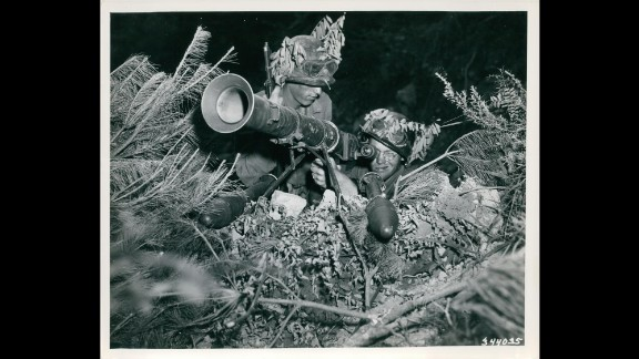 American soldiers fire a rocket launcher on the Korean front lines in July 1950. Photo ID: SC 344035