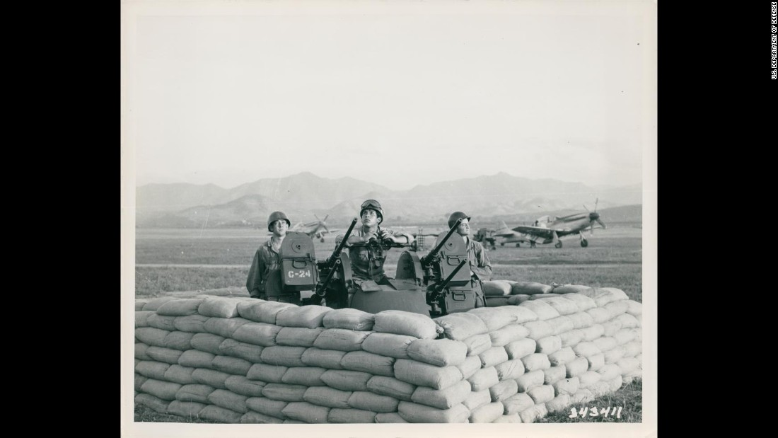 A U.S. gun crew keeps a sharp lookout for enemy planes at an airstrip somewhere in Korea in July 1950. Photo ID: SC 343411