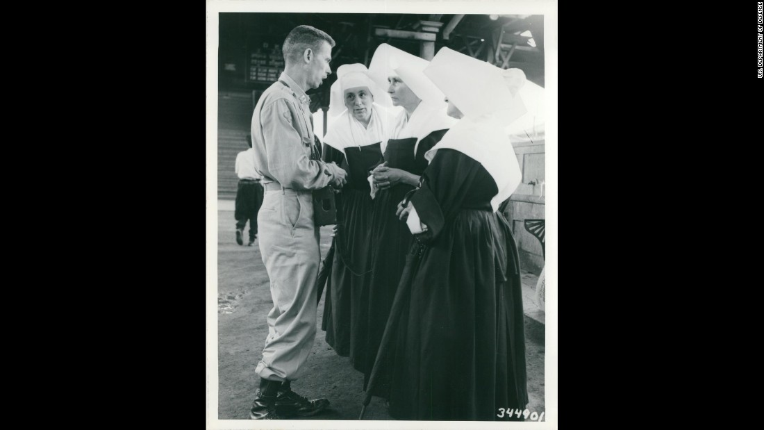 An unidentified U.S. Army captain speaks with three nuns at a railroad station somewhere in Korea in July 1950. Photo ID: SC 344901