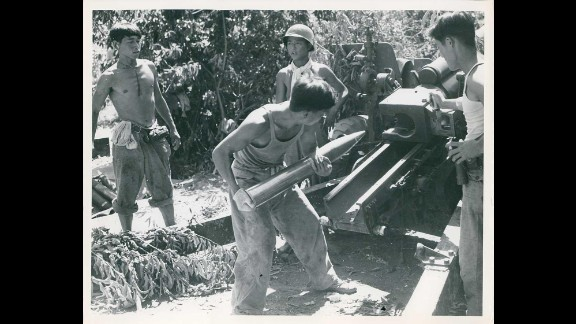 South Korean troops fire artillery in support of the 1st Korean Infantry Division in July 1950. Photo ID: SC 344424