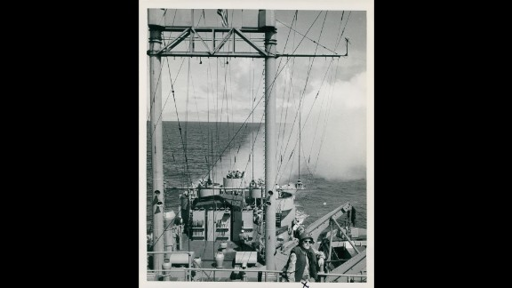Ships heading to Korea under the command of Rear Adm. James E. Doyle practice laying smoke screens in July 1950. Photo ID: SC 343649