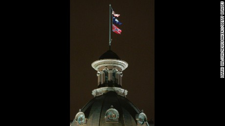 The Confederate flag flies on the dome of the Statehouse in Columbia, SC, before it is moved.