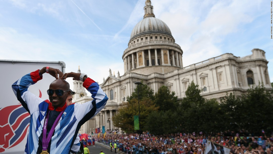 "Farah recreates his ""Mobot"" celebration during the London 2012 Victory Parade on September 10, 2012 in front of St Paul's Cathedral."