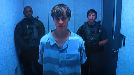 Accused Charleston church shooter Dylann Roof looked solemn as he appeared remotely by video before a judge on June 19, 2015.