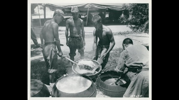 South Korean combat troops prepare a meal in July 1950. Photo ID: SC 343635
