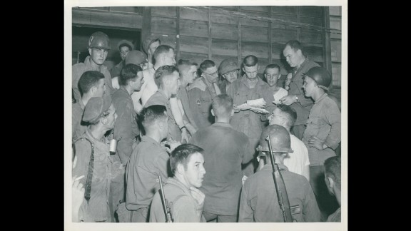 Unidentified soldiers of the 13th Signal Company, 1st Cavalry Division hope for a package or letter from home during mail call in July 1950. Photo ID: SC 344600