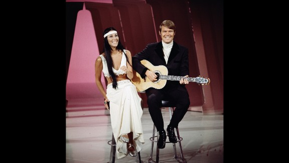 "Cher performs with Campbell on ""The Glen Campbell Goodtime Hour,"" which aired on CBS from 1969 to 1972. ""Gentle on My Mind"" was the theme song of the show."