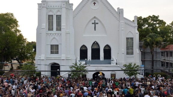 People que to lay flowers at Emanuel AME Church in Charleston, South Carolina on June 19, 2015. Police captured the white suspect in a gun massacre at one of the oldest black churches in the United States, the latest deadly assault to feed simmering racial tensions. Police detained 21-year-old Dylann Roof, shown wearing the flags of defunct white supremacist regimes in pictures taken from social media, after nine churchgoers were shot dead during bible study on June 17. AFP PHOTO/MLADEN ANTONOV        (Photo credit should read MLADEN ANTONOV/AFP/Getty Images)