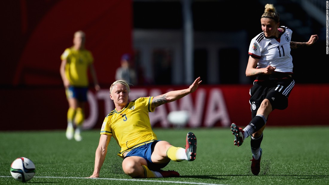 Germany's Anja Mittag takes a shot past Linda Sembrant.