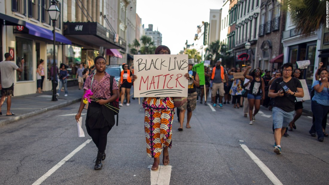 "Louise Brown walks down King Street during a ""Black Lives Matter"" march on June 20 in Charleston, South Carolina."