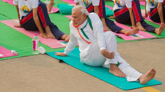 Modi, 64, performs an exercise to stretch the back. He appointed the country's first minister for yoga, Shripad Yesso Naik, in a government push to get more Indians involved.