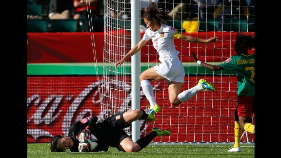 Chinese goalkeeper Wang Fei saves a shot during a round-of-16 match against Cameroon on Saturday, June 20. China defeated Cameroon 1-0 in Edmonton.