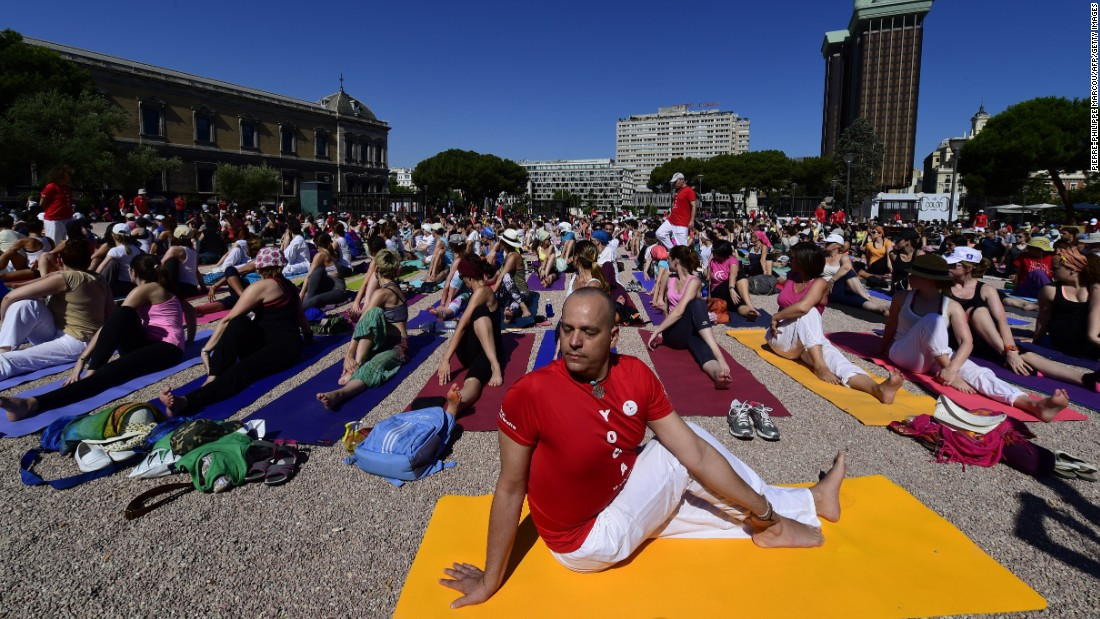Events similar to the one held in New Delhi were held around the world.  Here participants take part in a mass yoga session at Colon square in Madrid.