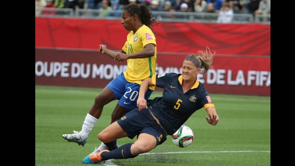 Australia's Laura Alleway, right, defends against Brazil midfielder Formiga during a match June 21 in Moncton, New Brunswick. Australia upset Brazil 1-0 to advance to the quarterfinals.