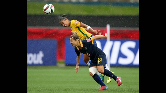 Fabiana heads the ball above Australia