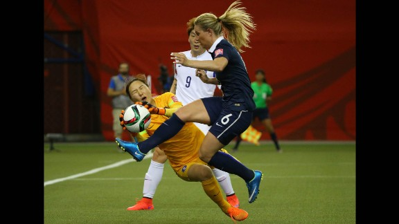 South Korean goalkeeper Kim Jung-mi makes a save against France