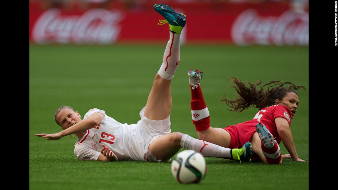 Switzerland's Ana Maria Crnogorcevic and Canada's Allysha Chapman collide during the first half.
