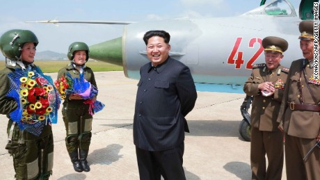 "Kim Jong-Un meets with North Korea's first female fighter jet pilots in this undated picture released by North Korea's state media on Monday, June 22. He called the women ""heroes of Korea"" and ""flowers of the sky."""