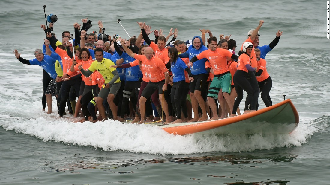 66 Surfers Pile Onto Giant Board Set
