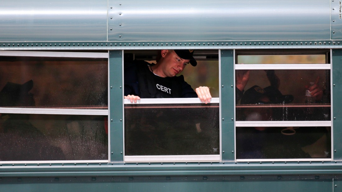 A bus transports corrections officers to a search area in Mountain View, New York, on June 22.