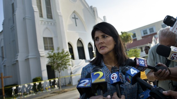 South Carolina Governor Nikki Haley speaks to press outside the Emanuel AME Church June 19, 2015 in Charleston, South Carolina.US police arrested a white high school dropout Thursday suspected of carrying out a gun massacre at one of America