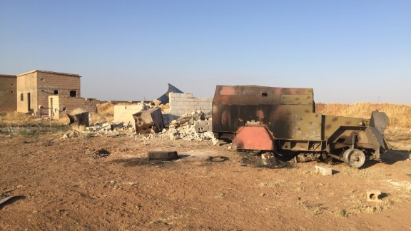 On a road that runs parallel to the Turkish border, the carcasses of ISIS vehicles lay where they were hit by coalition airstrikes.