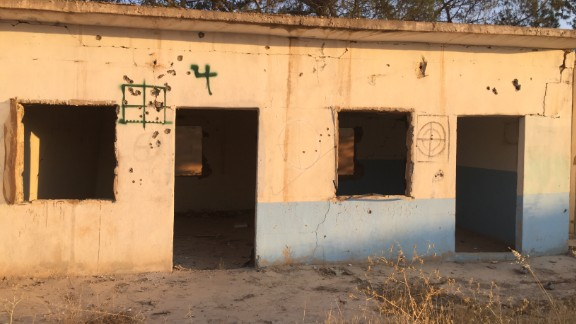 Target practice: Crosshairs are spray-painted on the walls of a former ISIS base near Mabrouka.
